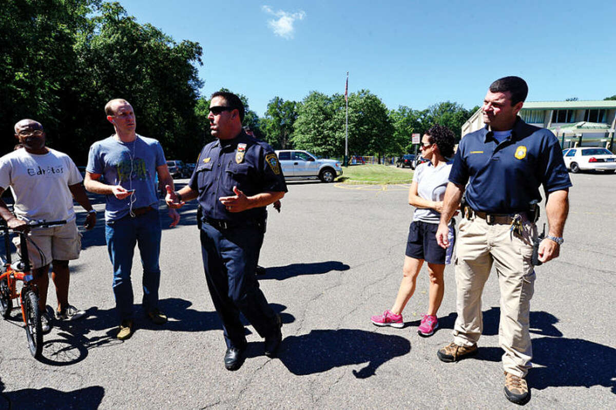 Norwalk Police Lt. Marc Lepore Lt. Brian Cunningham expalnis that all students are safe after worried parents came to Cranbury Elemntary School after a teacher reported hearing gunfire and the school was put on lockdown. Hour photo / Erik Trautmann