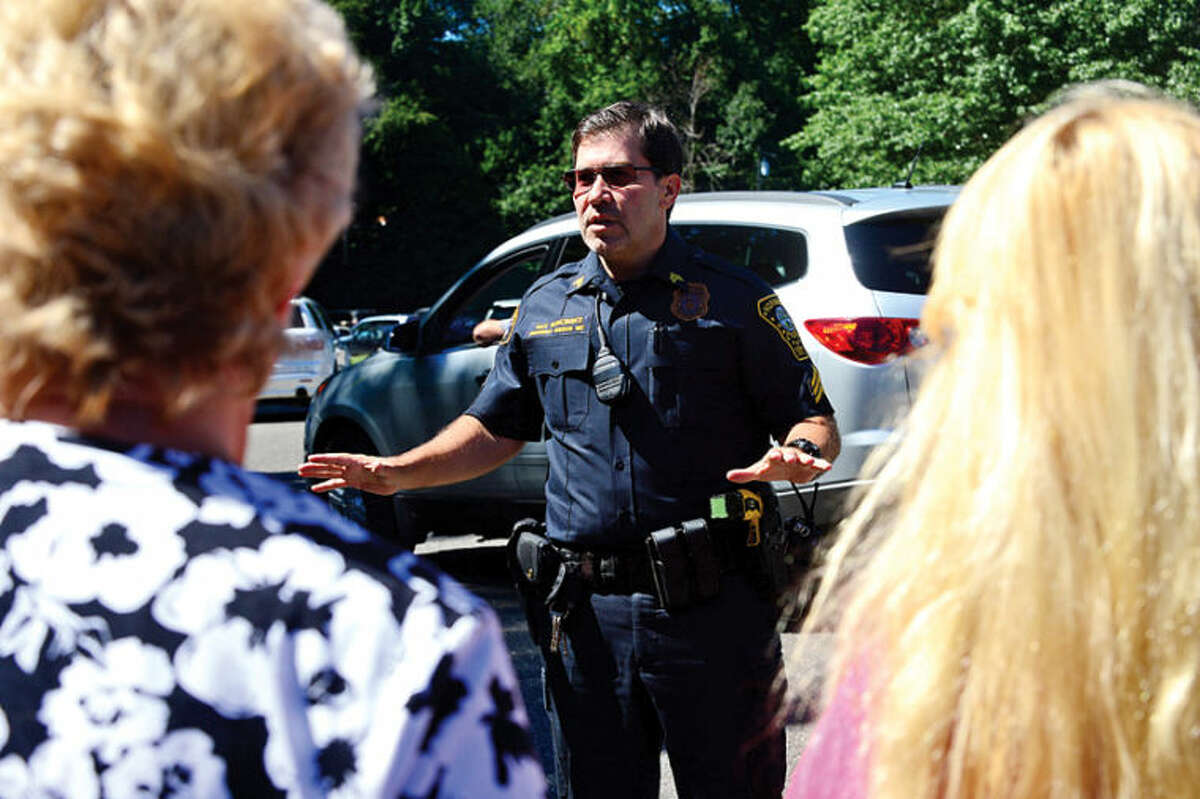 Norwalk Police Sgt. Thomas Roncinske expalnis that all students are safe after worried parents came to Cranbury Elementary School after a teacher reported hearing gunfire and the school was put on lockdown. Hour photo / Erik Trautmann