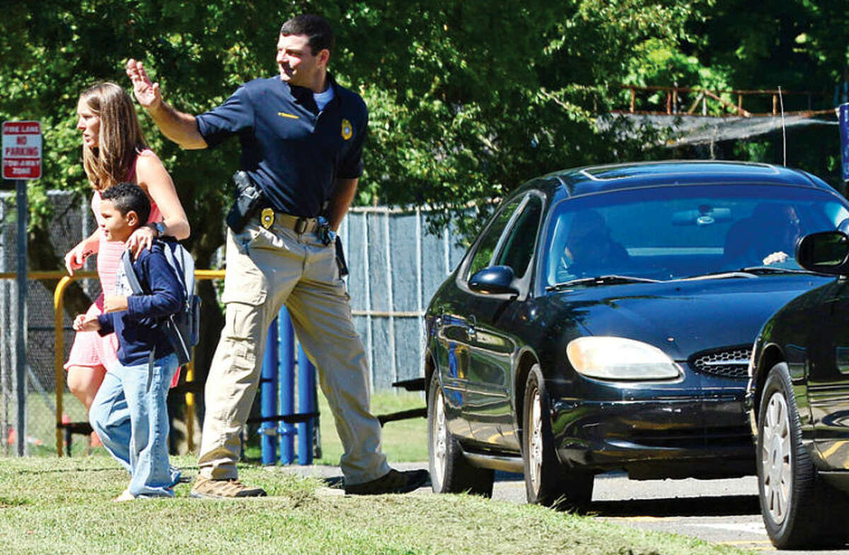 Police and worried parents respond to Cranbury Elementary School after a teacher reported hearing gunfire and the school was put on lockdown. Hour photo / Erik Trautmann