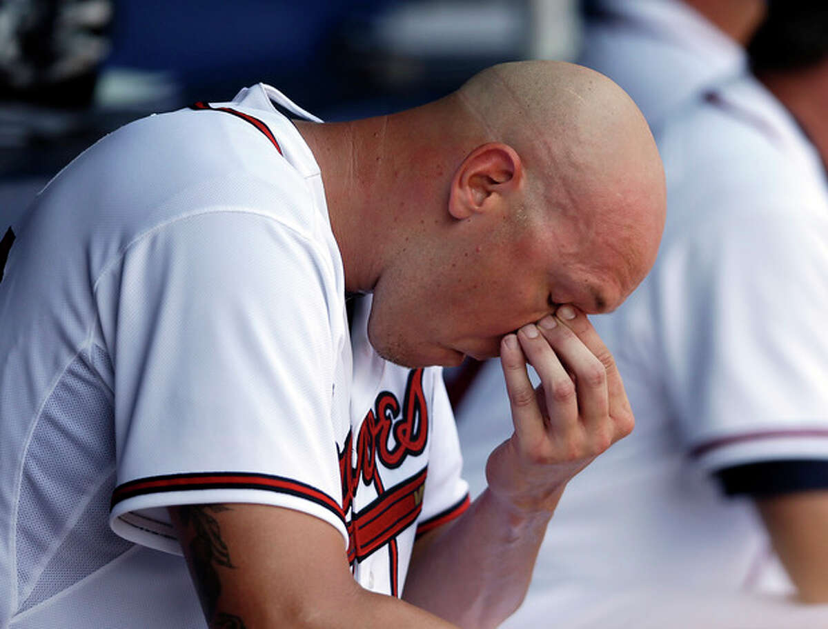 Atlanta Braves pitcher Kameron Loe sits in the dugout after being relieved in the fifth inning of a baseball game against the New York Mets Wednesday, Sept. 4, 2013, in Atlanta. (AP Photo/John Bazemore)