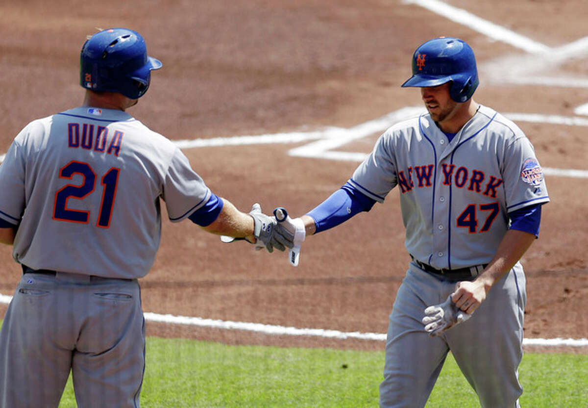 New York Mets' Andrew Brown (47) is greeted by teammate Lucas Duda (21) after hitting a two-run home run in the first inning of a baseball game against the Atlanta Braves Wednesday, Sept. 4, 2013, in Atlanta. (AP Photo/John Bazemore)
