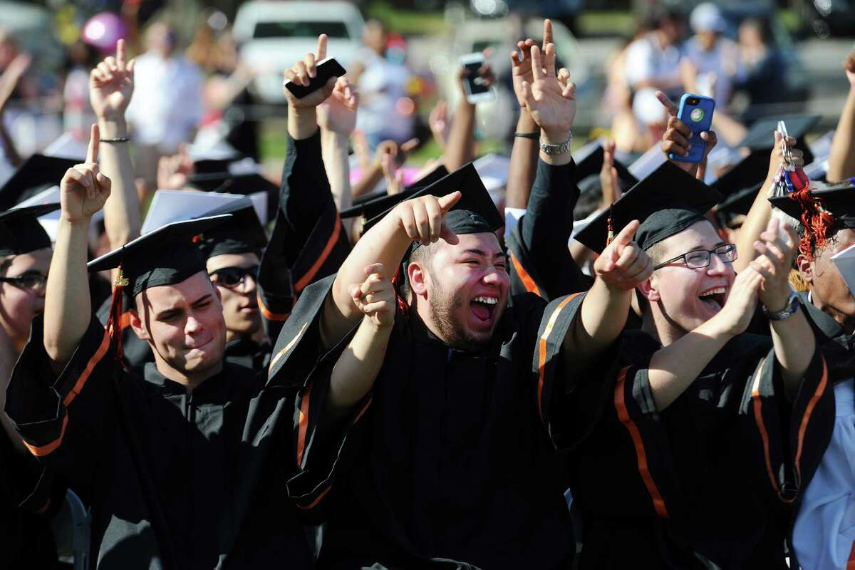 From left, Austin Caporale, Andy Gonzalez and Kristian Dushi cheer their classmates during the Stamford High School graduation on Wednesday, June 15, 2016.
