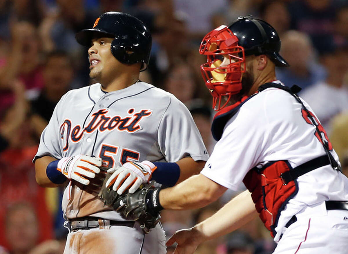 Boston Red Sox catcher David Ross applies the tag on Detroit Tigers' Brayan Pena trying to score on a double by Jose Iglesias in the second inning of a baseball game at Fenway Park in Boston, Tuesday, Sept. 3, 2013. (AP Photo/Elise Amendola)