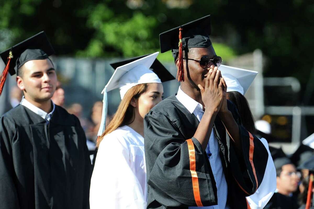 Christopher Thomas waits for his name to be called to receive his diploma during the Stamford High School graduation held on the football field on Wednesday, June 15, 2016.