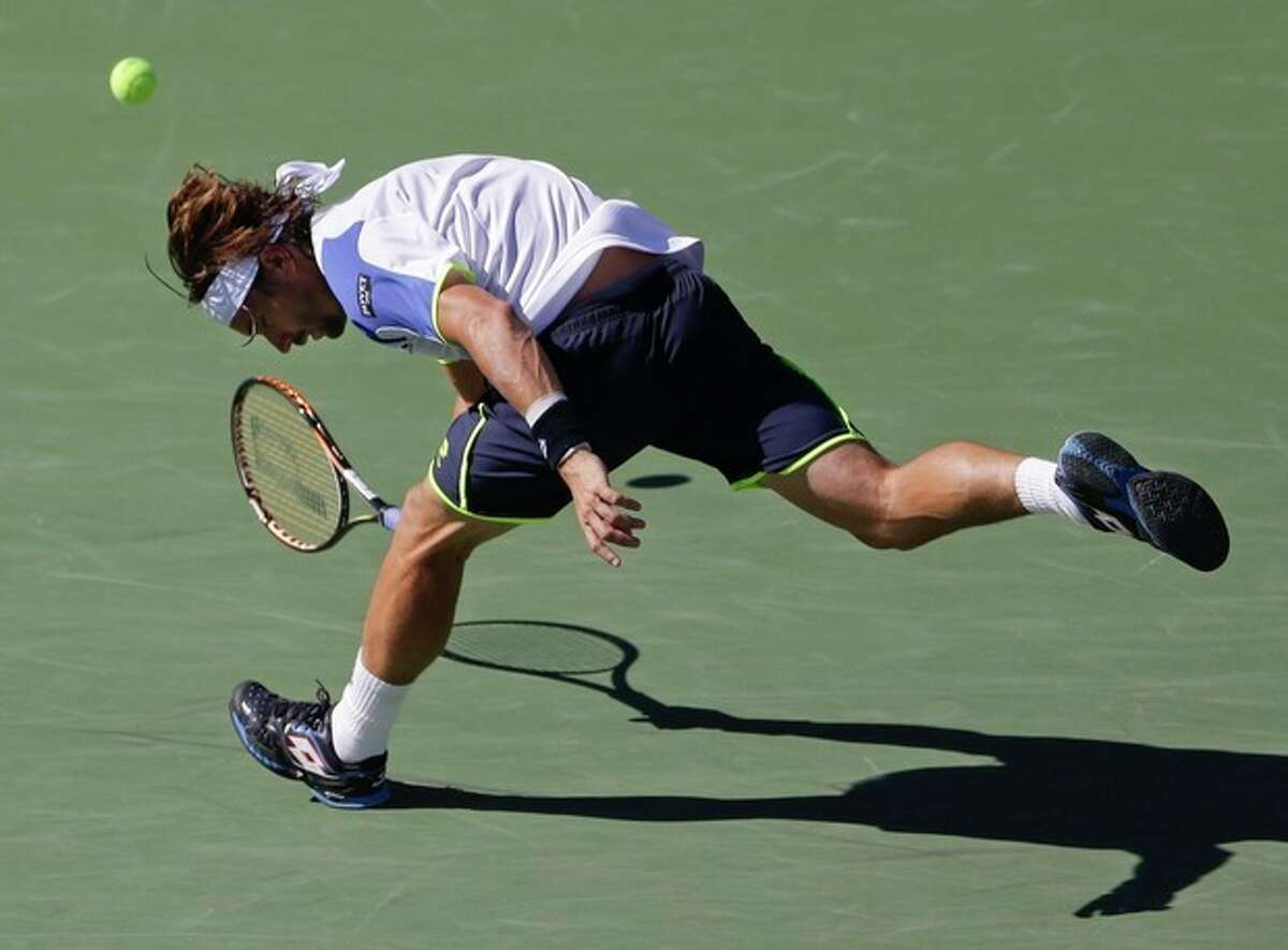 David Ferrer, of Spain, misses a shot by Richard Gasquet, of France, during the quarterfinals of the 2013 U.S. Open tennis tournament, Wednesday, Sept. 4, 2013, in New York. (AP Photo/Julio Cortez)