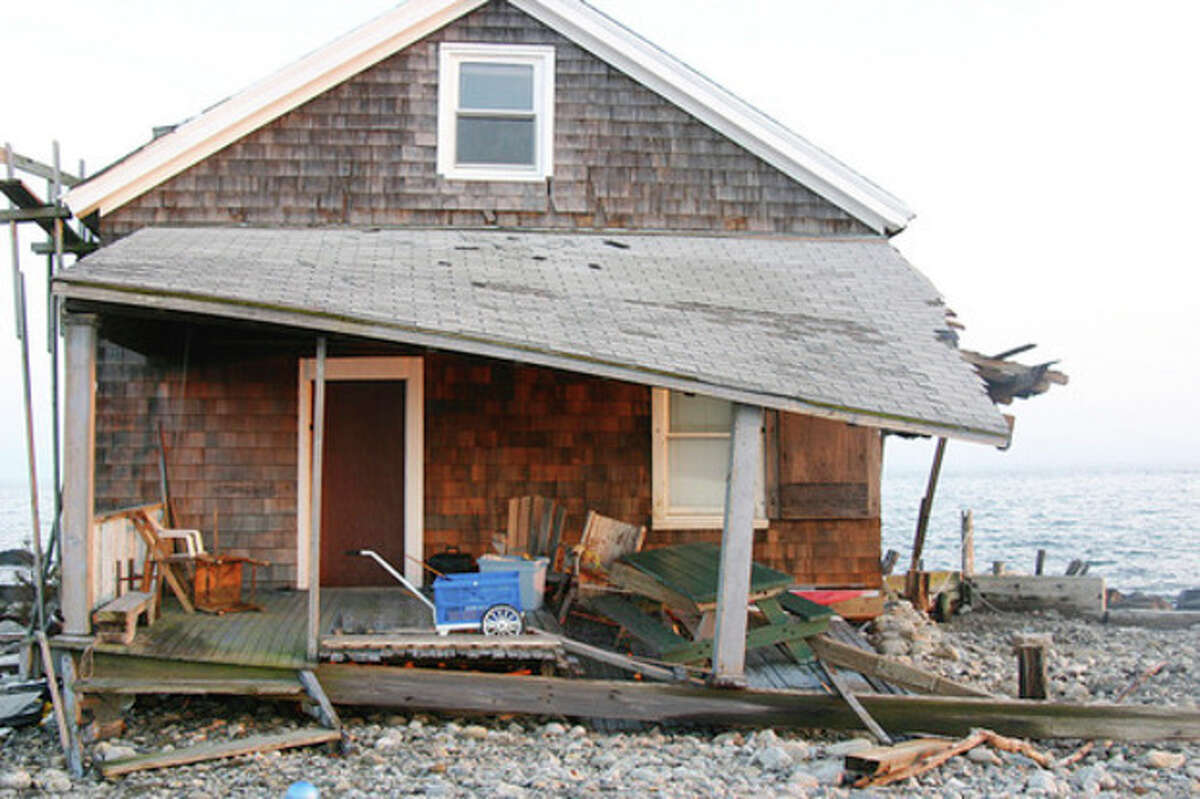 Hour photo / Chris Bosak A small structure on Sheffield Island was damaged by Hurricane Sandy.