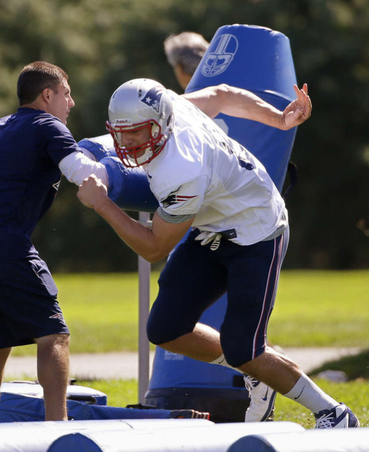 New England Patriots tight end Rob Gronkowski (87) pushes off a block during practice at the NFL football team's facility in Foxborough, Mass., Wednesday Sept. 4, 2013. The Patriots open their regular season against the Buffalo Bills on Sunday. (AP Photo/Stephan Savoia)