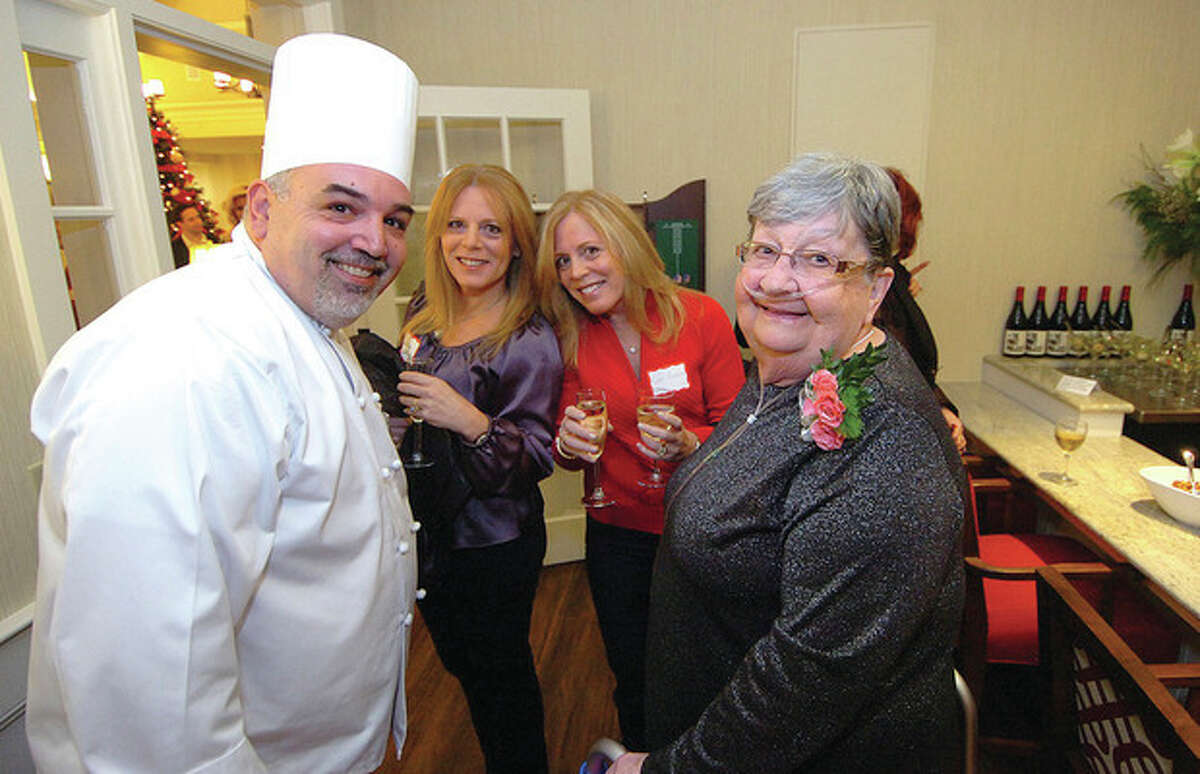 Hour photos / Alex von Kleydorff Chef Joe Dostilio, culinary services director, mingles with some of the residents and guests in the Pub at Maplewood Senior Living on Tuesday.
