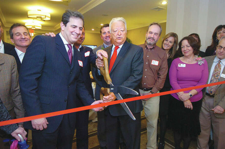 Mayor Richard A. Moccia cuts the ribbon at Maplewood Senior Living, 73 Strawberry Hill Ave., during the official opening on Tuesday. / 2012 The Hour Newspapers/Alex von Kleydorff