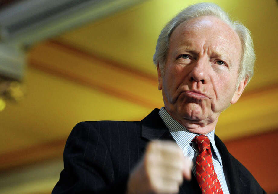 FILE - This Dec. 10, 2012 file photo, Sen. Joseph Lieberman, I-Conn. gestures during a news conference at the state capitol in Hartford, Conn. Retiring Sen. Joe Lieberman in his final Senate floor speech is urging Congress to put partisan rancor aside and reach across party lines to break Washington's gridlock. (AP Photo/Jessica Hill, File) / FR125654 AP