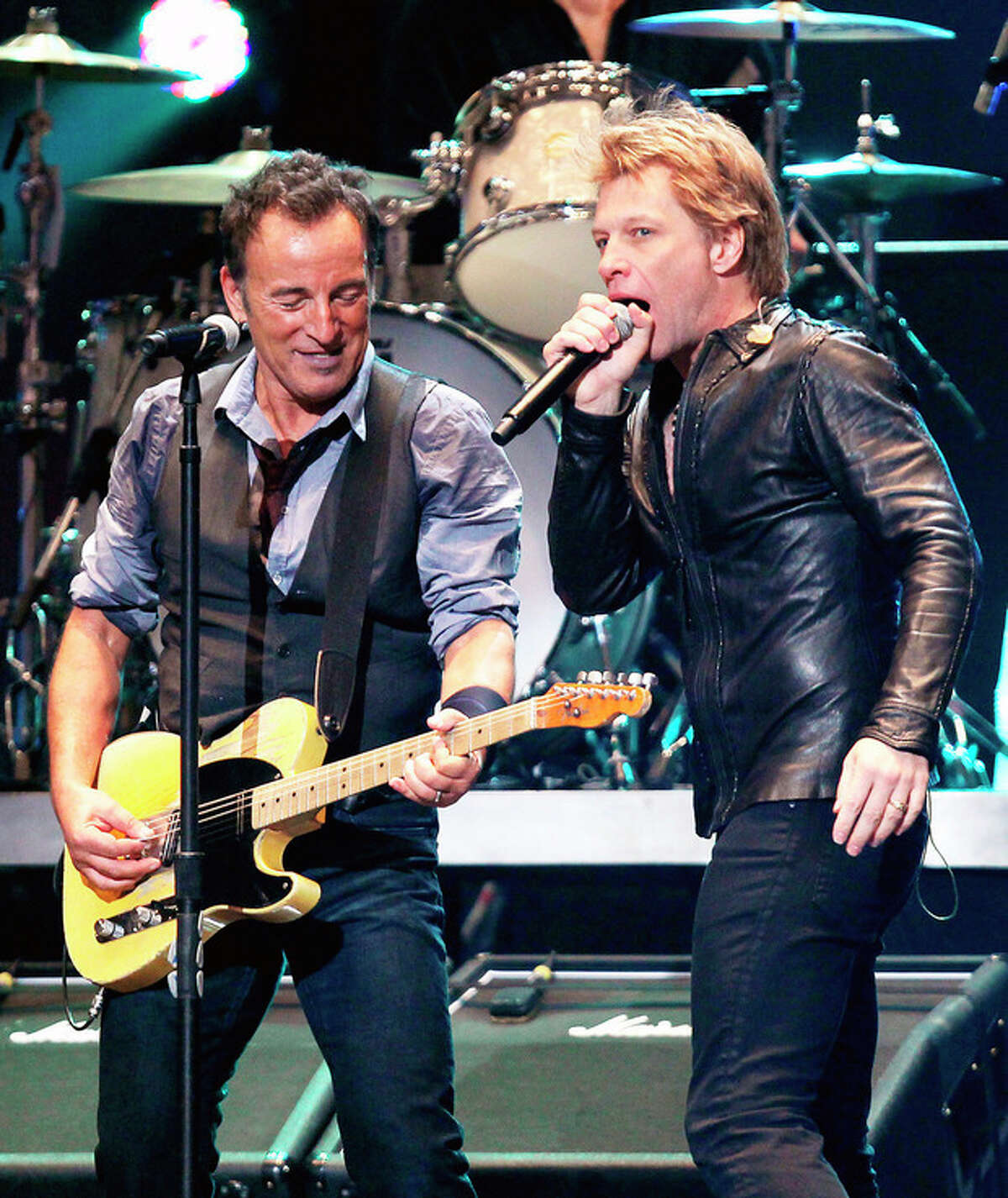 AP Photo/Starpix, Dave Allocca This image released by Starpix shows Bruce Springsteen, left, and Jon Bon Jovi performing at the 12-12-12 The Concert for Sandy Relief at Madison Square Garden in New York on Wednesday, Dec. 12. Proceeds from the show will be distributed through the Robin Hood Foundation.