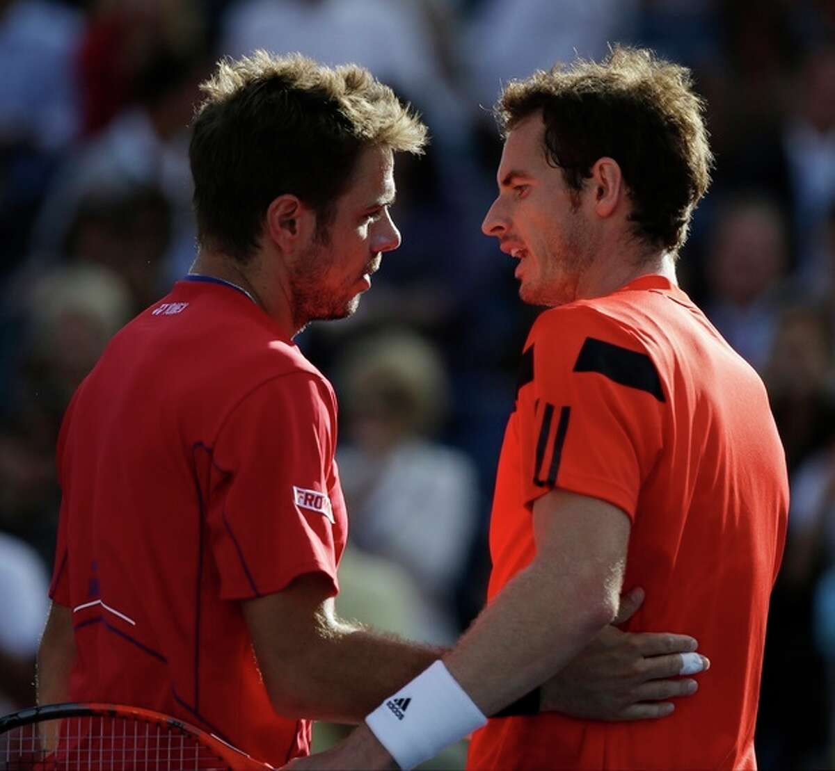 Stanislas Wawrinka, of Switzerland, left, greets Andy Murray, of Great Britain, at the net after beating him in straight sets during the quarterfinals of the 2013 U.S. Open tennis tournament, Thursday, Sept. 5, 2013, in New York. (AP Photo/David Goldman)