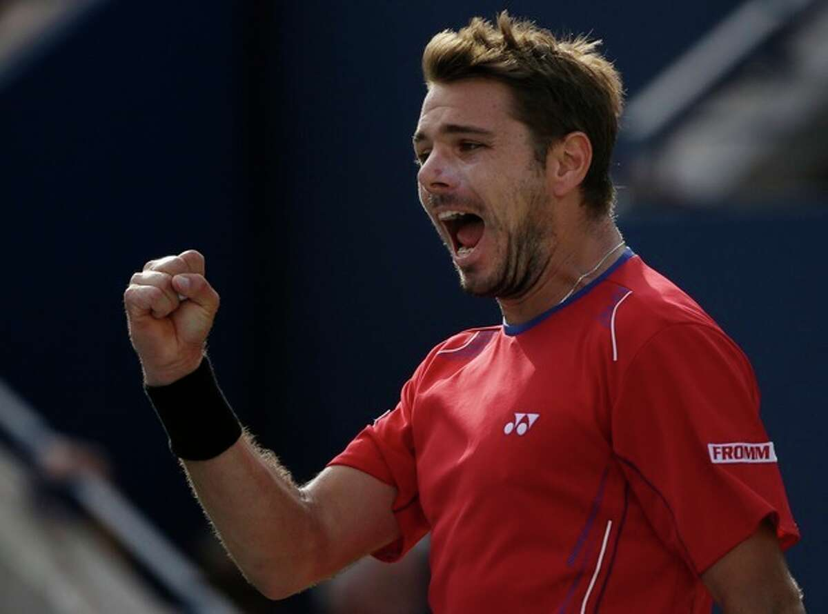 Stanislas Wawrinka, of Switzerland, reacts after winning a game against Andy Murray, of Great Britain, during the quarterfinals of the 2013 U.S. Open tennis tournament, Thursday, Sept. 5, 2013, in New York. (AP Photo/David Goldman)