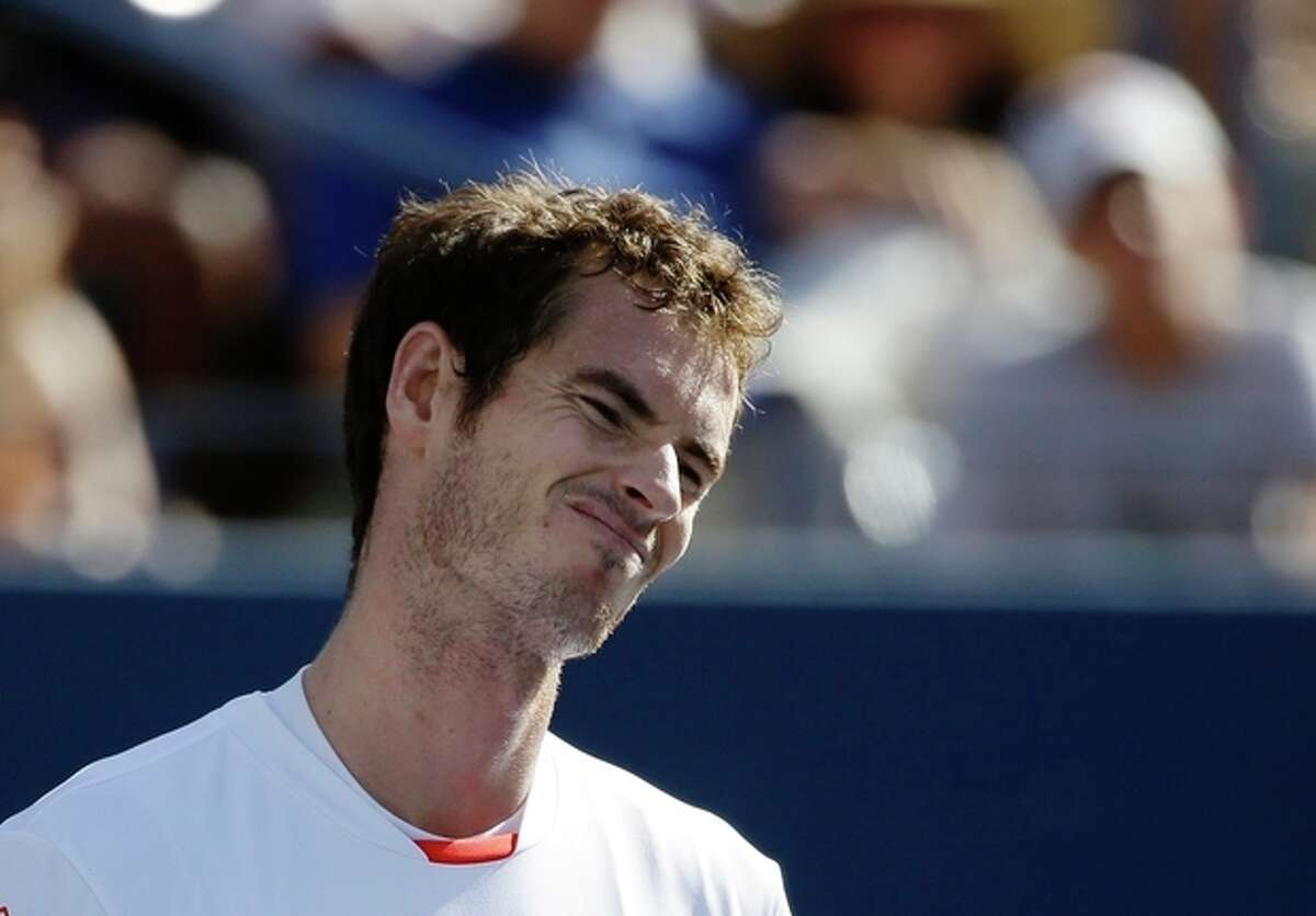 Andy Murray, of Great Britain, reacts after losing point to Stanislas Wawrinka, of Switzerland, during the quarterfinals of the 2013 U.S. Open tennis tournament, Thursday, Sept. 5, 2013, in New York. (AP Photo/David Goldman)