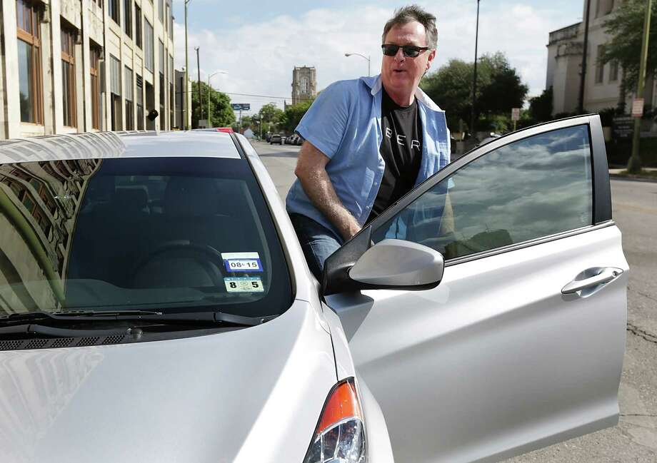 Dale Blankenship, an Uber driver, drives around downtown San Antonio.  Wednesday, Oct. 8, 2014. Photo: BOB OWEN, Staff / San Antonio Express-News / © 2014 San Antonio Express-News