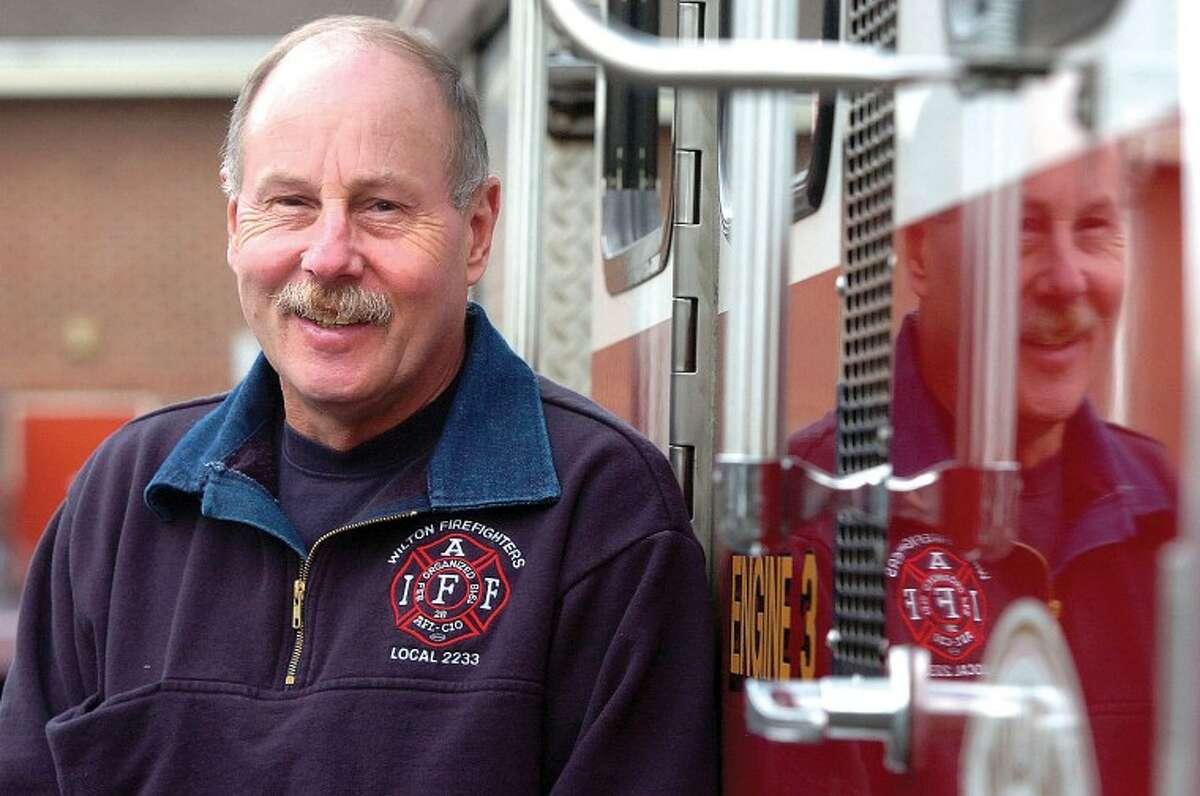 Hour Photo/Alex von Kleydorff. Capt. Karl Dolnier just retired from Wilton Fire Dept