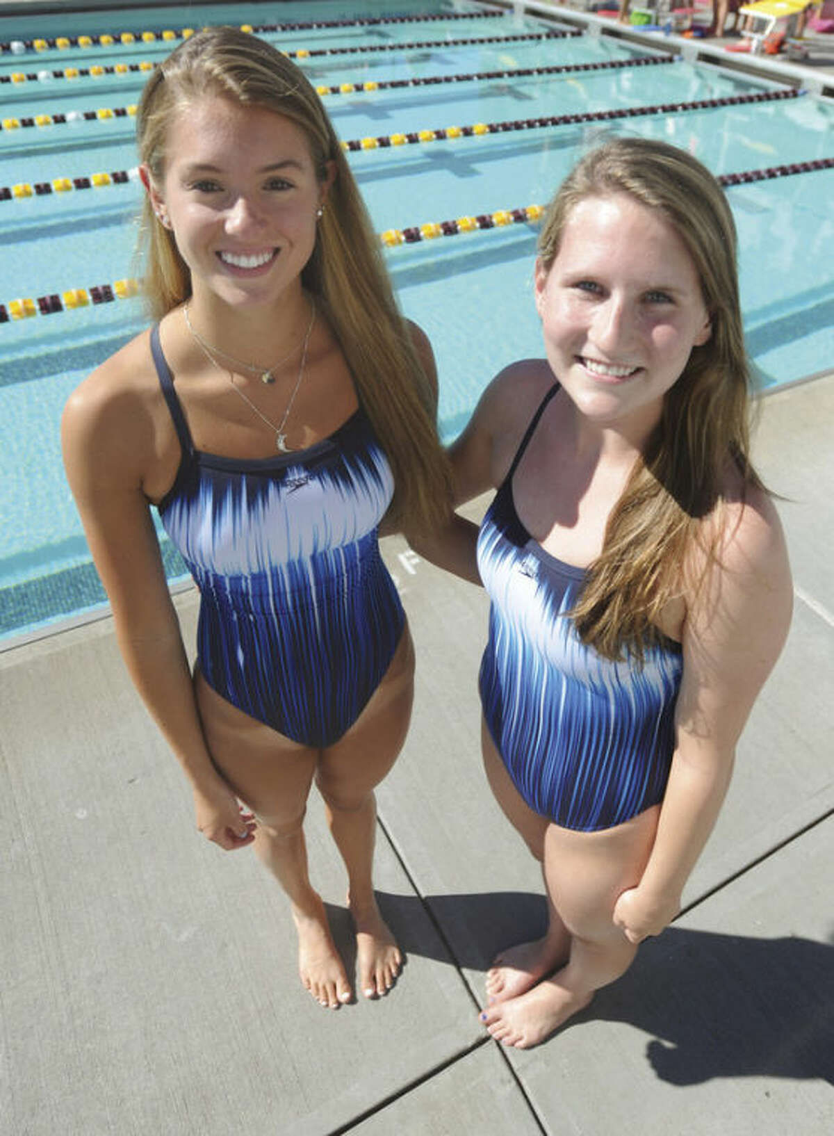Hour photo/John Nash For the past three seasons, Wilton seniors Kristen Moss, left, and Steph Moriarty have been among the Warriors best swimmers. They will be the leaders this season for a Warriors' squad aiming to live up to the program's high standards.