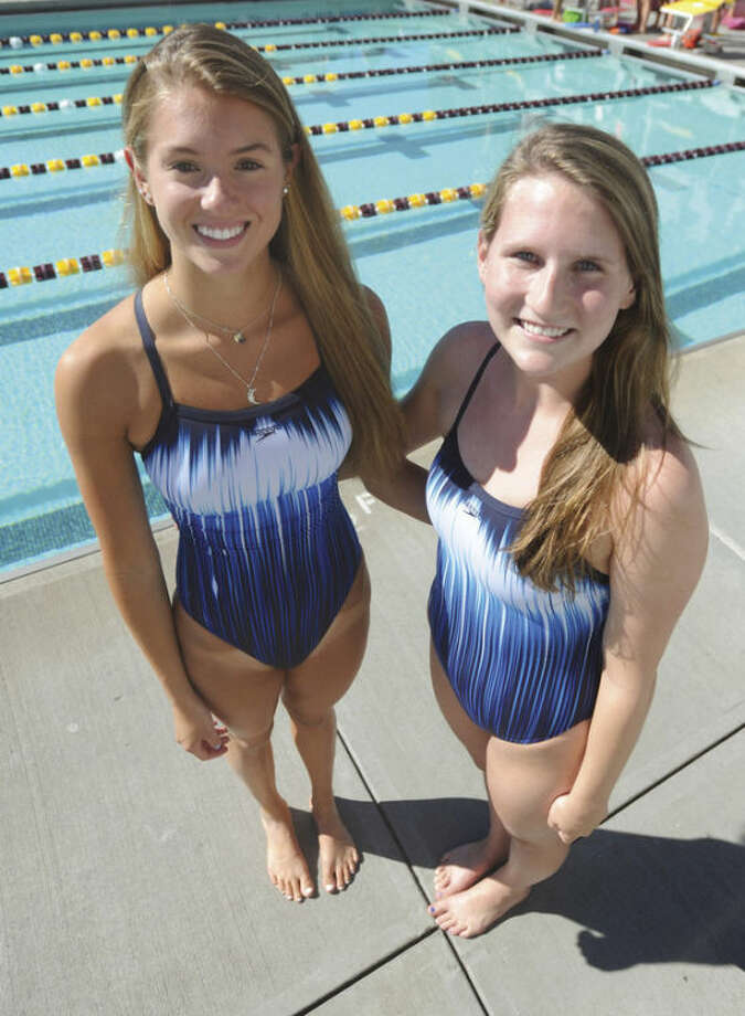 Hour photo/John NashFor the past three seasons, Wilton seniors Kristen Moss, left, and Steph Moriarty have been among the Warriors best swimmers. They will be the leaders this season for a Warriors' squad aiming to live up to the program's high standards.