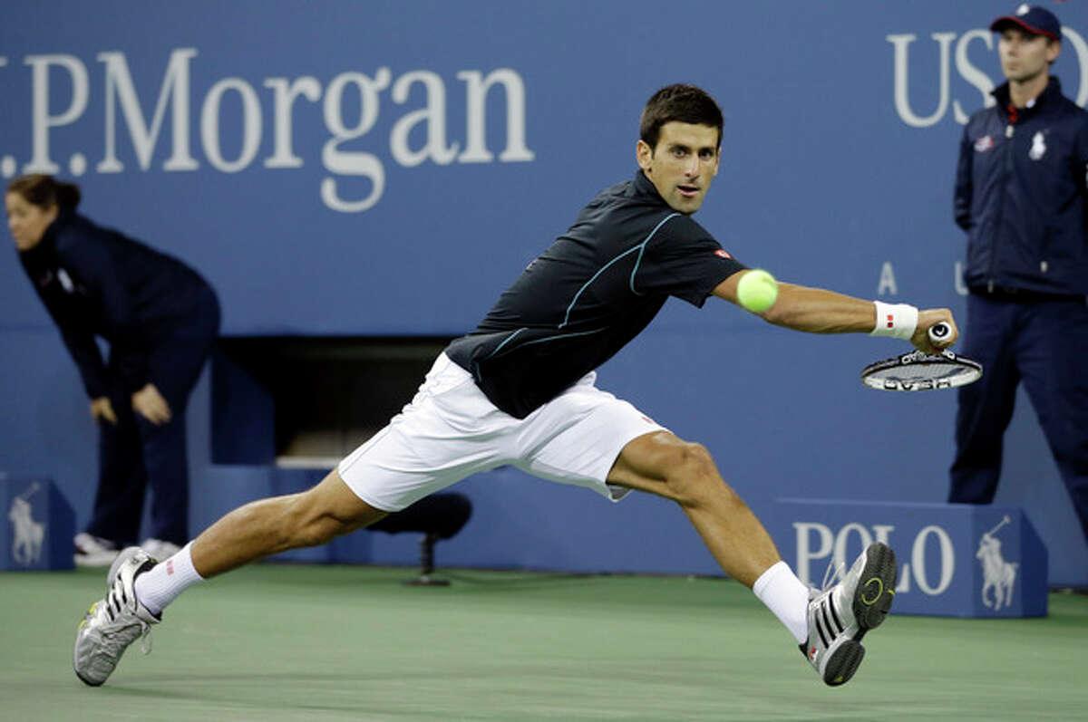 Novak Djokovic, Serbia, returns a shot toMikhail Youzhny, Russia, during a quarterfinal match at the 2013 U.S. Open tennis tournament, Thursday, Sept. 5, 2013, in New York. (AP Photo/Darron Cummings)