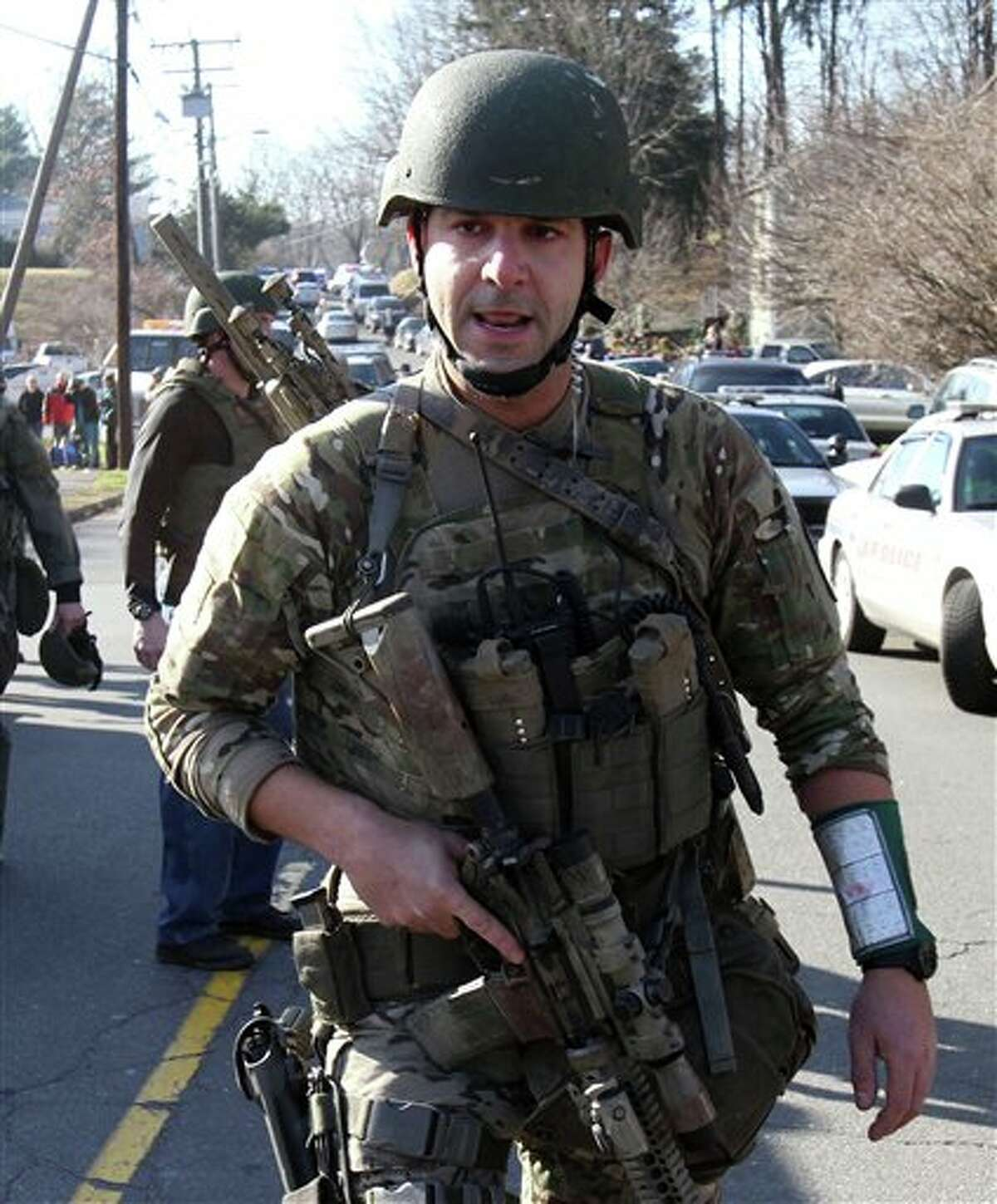 Heavily armed Connecticut State troopers are on the scene at the Sandy Hook School where authorities say a gunman opened fire, leaving 27 people dead, including 20 children, Friday, Dec. 14, 2012. (AP Photo/The Journal News, Frank Becerra Jr.) MANDATORY CREDIT, NYC OUT, NO SALES, TV OUT, NEWSDAY OUT; MAGS OUT