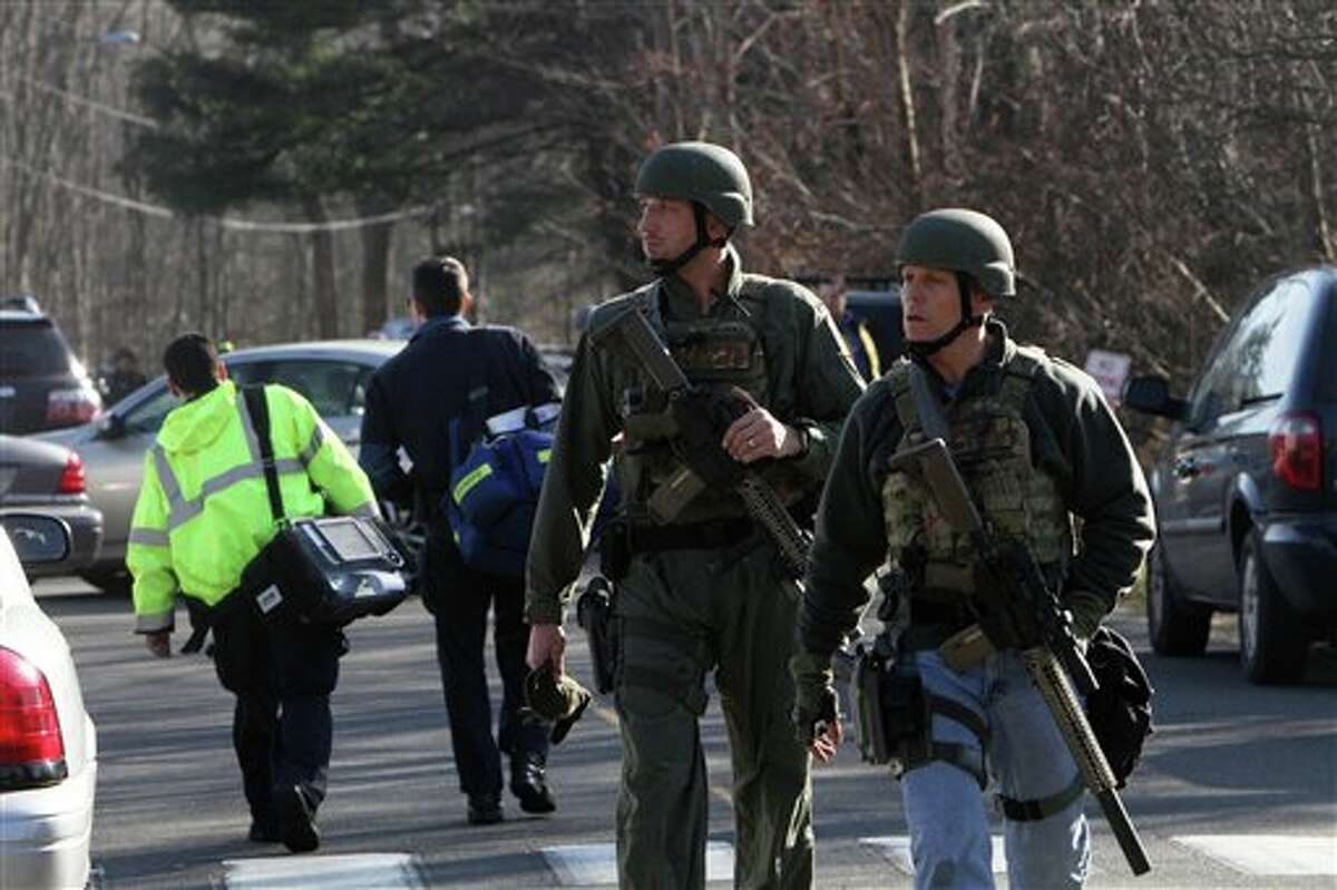 Heavily armed Connecticut State troopers are on the scene at the Sandy Hook School following a shooting at the school, Friday, Dec. 14, 2012 in Newtown, Conn. (AP Photo/The Journal News, Frank Becerra Jr.) MANDATORY CREDIT, NYC OUT, NO SALES, TV OUT, NEWSDAY OUT; MAGS OUT