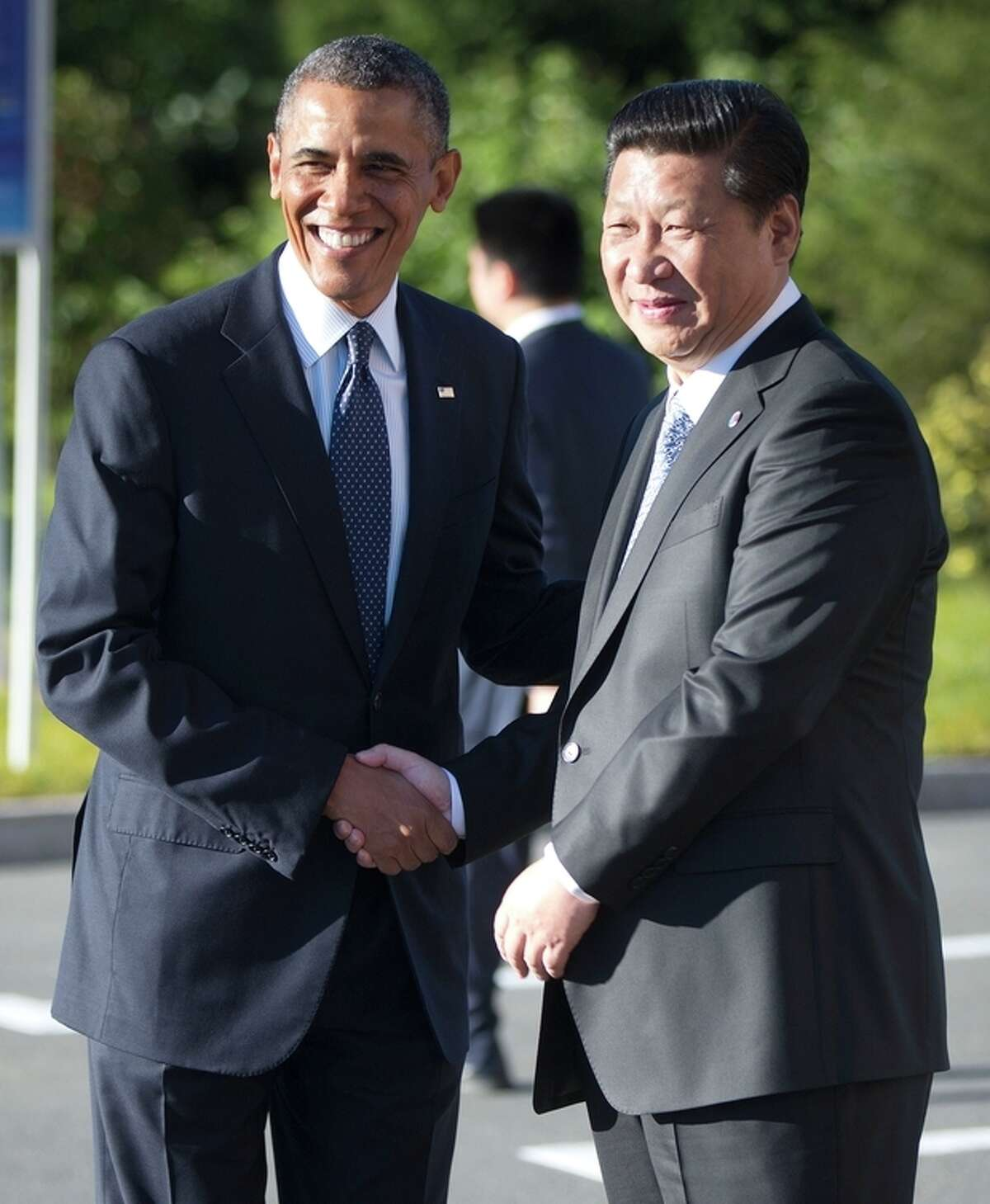 U.S. President Barack Obama, left, and China's President Xi Jinping, right, shake hands before their bilateral meeting at the G20 Summit, Friday, Sept. 6, 2013 in St. Petersburg, Russia. (AP Photo/Pablo Martinez Monsivais)