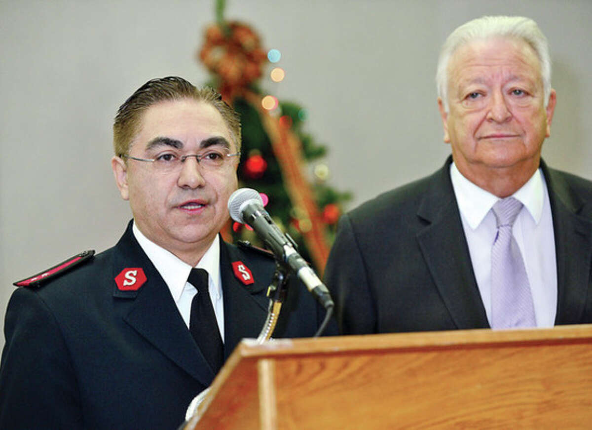 Capt. Diego Bedoya of the Salvation Army thanks mayor Moccia and the city for the gift donation during the city's Holiday Gift Giving Ceremony Thursday. Hour photo / Erik Trautmann