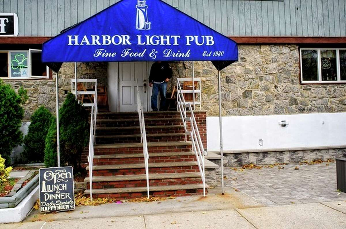 In this Oct. 28, 2013 photo provided by Michael Schor Photography, the Harbor Light Pub, in the Rockaway section of the Queens borough of New York, is shown. The venue was a gathering place for local families who lost loved ones in the terrorist attacks of September 11, 2011. The establishment was destroyed in the fires that engulfed the Rockaways in Superstorm Sandy, taking with it dozens of photos on the walls of the people from the neighborhood killed in the attacks. (AP Photo/Michael Schor) NO SALES