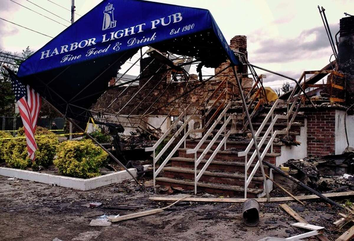 In this Oct. 31, 2013 photo provided by Michael Schor Photography, The Harbor Light Pub, in the Rockaway section of the Queens borough of New York, is shown. The establishment was destroyed in the fires that engulfed the Rockaways in Superstorm Sandy, taking with it dozens of photos on the walls of the people from the neighborhood who were killed in the September 11, 2001 terrorist attacks. (AP Photo/Michael Schor) NO SALES