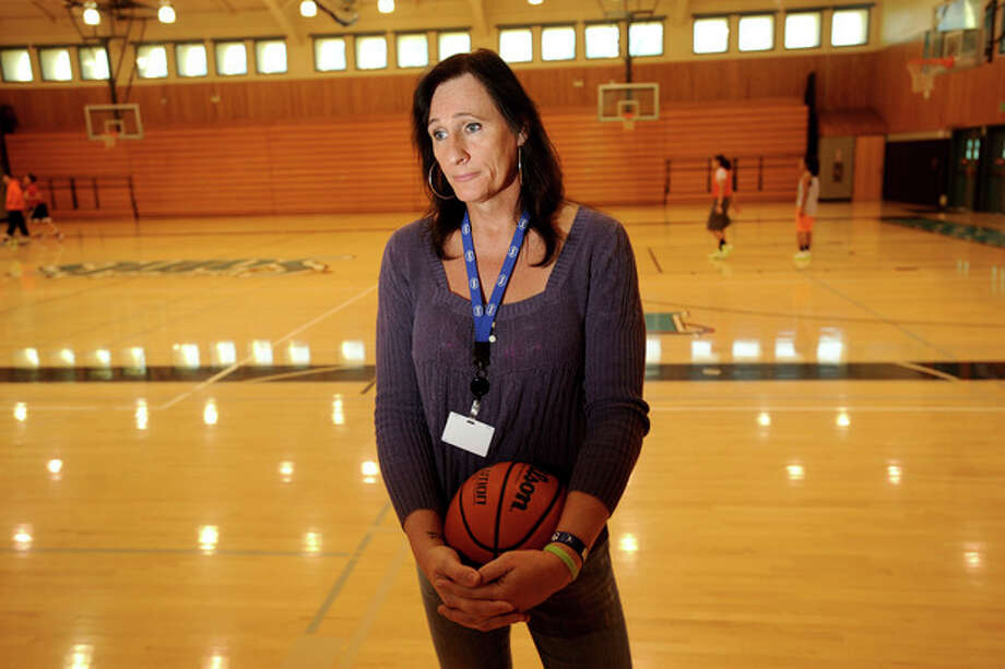 Gabrielle Ludwig, a 6-foot-6-inch transsexual player on Mission College's women's basketball squad, reflects on her return to college ball on Friday, Dec. 7, 2012, in Santa Clara, Calif. Gabrielle Ludwig made sports history this month as a basketball player at a Northern California community college. The 50-year-old transsexual, Army veteran, father and Mission College freshman is believed to be the first hoopster to play college ball as both a man and a woman. (AP Photo/Noah Berger) / FR34727 AP