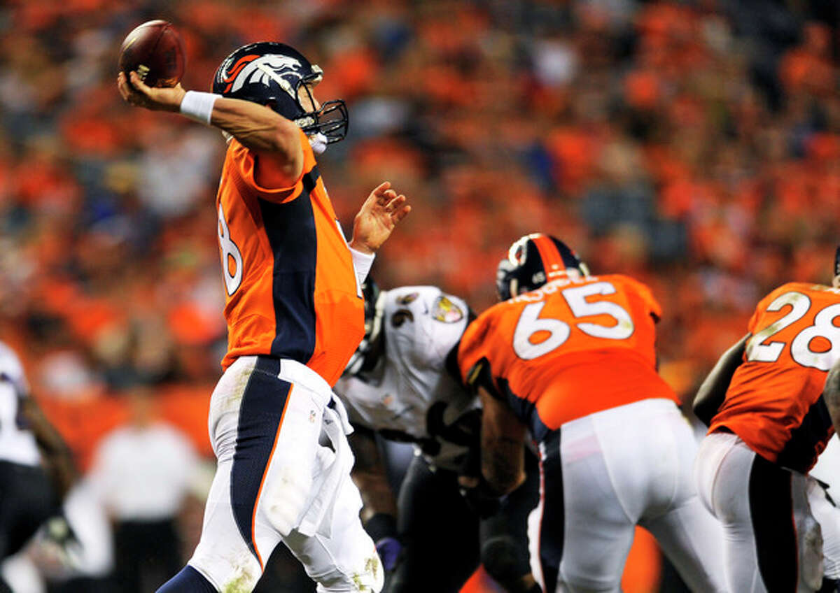 Denver Broncos quarterback Peyton Manning (18) throws his seventh touchdown of the game against the Baltimore Ravens during the second half of an NFL football game, Thursday, Sept. 5, 2013, in Denver. The Broncos won 49-27. Manning threw a record-tying seven touchdown passes ?- something no one had done in 44 years. (AP Photo/Jack Dempsey)