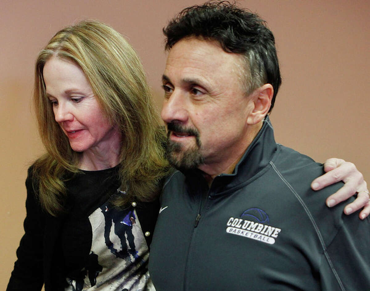 Frank DíAngelis, right, Columbine High School Principal at time of the 1999 school massacre and still principal today is comforted by long time friend Cindy Stevenson, Superintendent of JEFCO Schools after a news conference where Di'Angelis talked about the Connecticut School Shooting at Jefferson County School headquarters in Golden, Colo., on Thursday, Dec. 14, 2012. In a state that was rocked by the 1999 Columbine school massacre and the Aurora movie theater shooting less than six months ago, Friday?'s shootings renewed debate over why mass shootings keep occurring and whether gun control can stop them. (AP Photo/Ed Andrieski)
