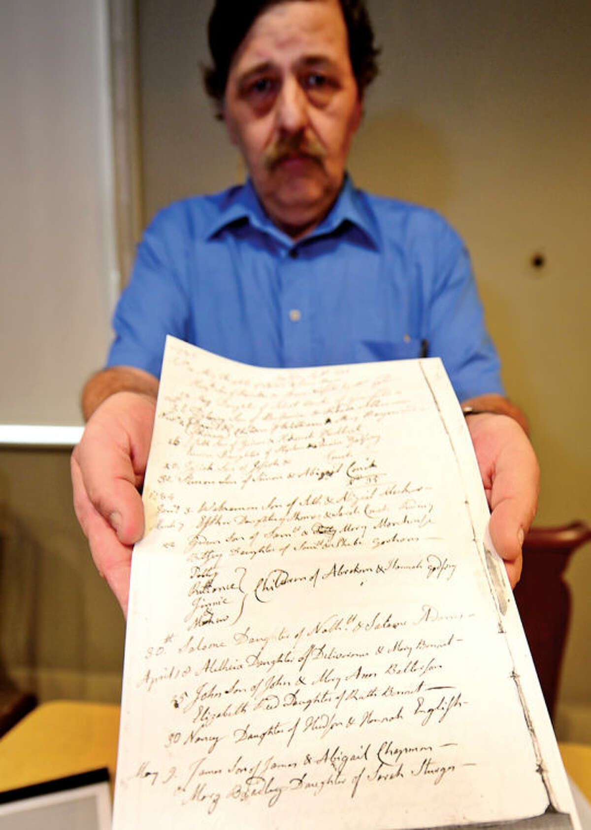Ed Eckert can trace his lineage back to Richard Olmstead who help found Norwalk back in 1651. Eckert holds a baptism certificate for Delancey Allen from 1783, part of his Norwalk lineage.