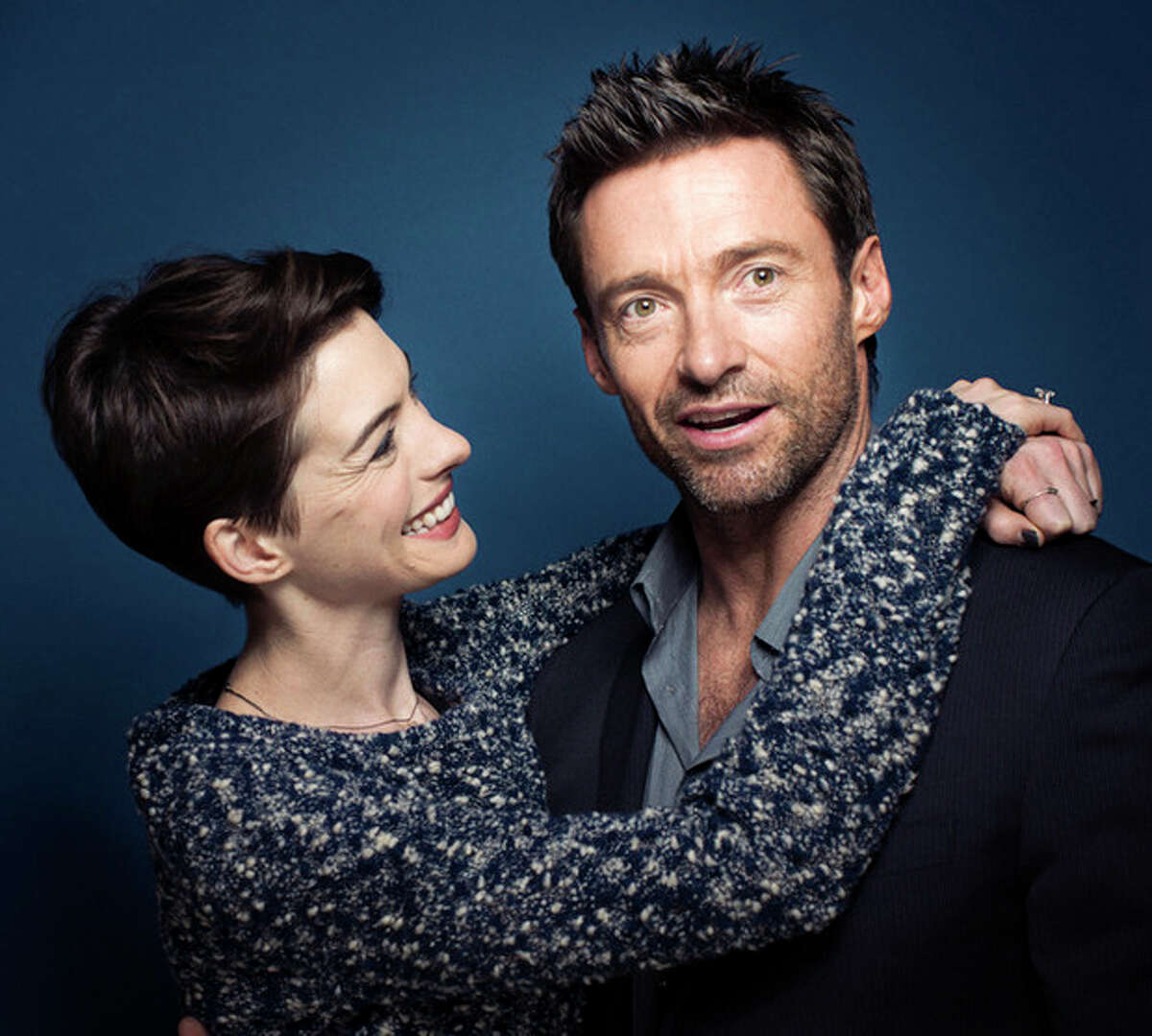 This Dec. 2, 2012 photo shows actors Anne Hathaway, left, and Hugh Jackman in New York. Hathaway portrays Fantine and Jackman portrays Jean Valjean in the film adaptation of the Victor Hugo novel,