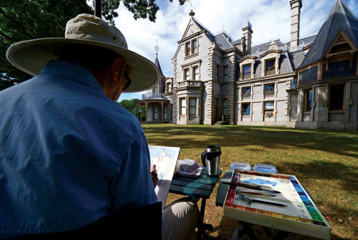 Rowayton Arts Center student Madeline Boucher paints the Lockwood Mathews Mansion Friday morning when the light was perfect. Hour photo / Erik Trautmann