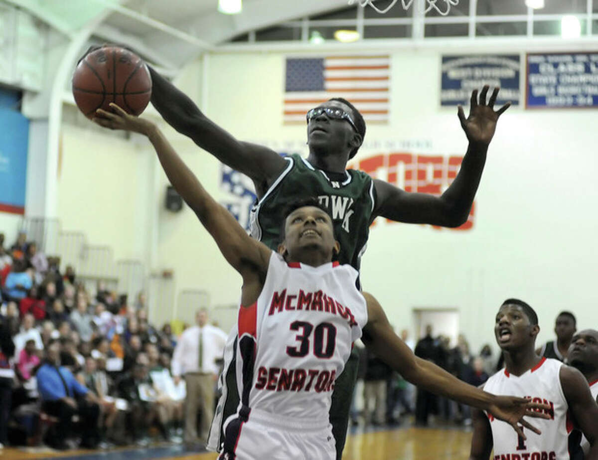 Hour photo/John Nash Norwalk's Roy Kane Jr., rear, blocks a shot by Brien McMahon's Andrew Rivera during the second half of Friday's city showdown between the two teams.
