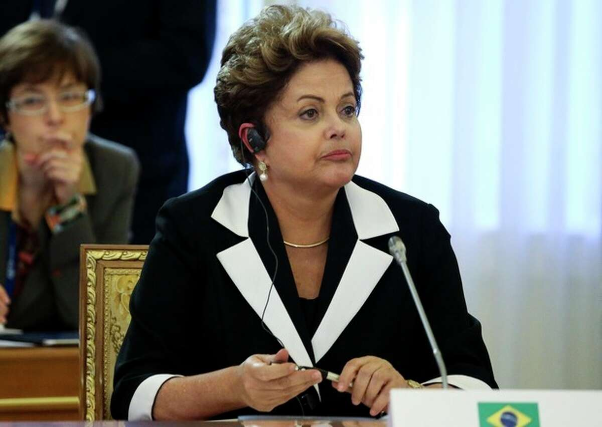 Brazil's President Dilma Rousseff listens during a round table meeting at the G-20 summit in St. Petersburg, Russia on Thursday, Sept. 5, 2013. The threat of missiles over the Mediterranean is weighing on world leaders meeting on the shores of the Baltic this week, and eclipsing economic battles that usually dominate when the G-20 world economies meet. (AP Photo/Sergei Karpukhin, Pool)