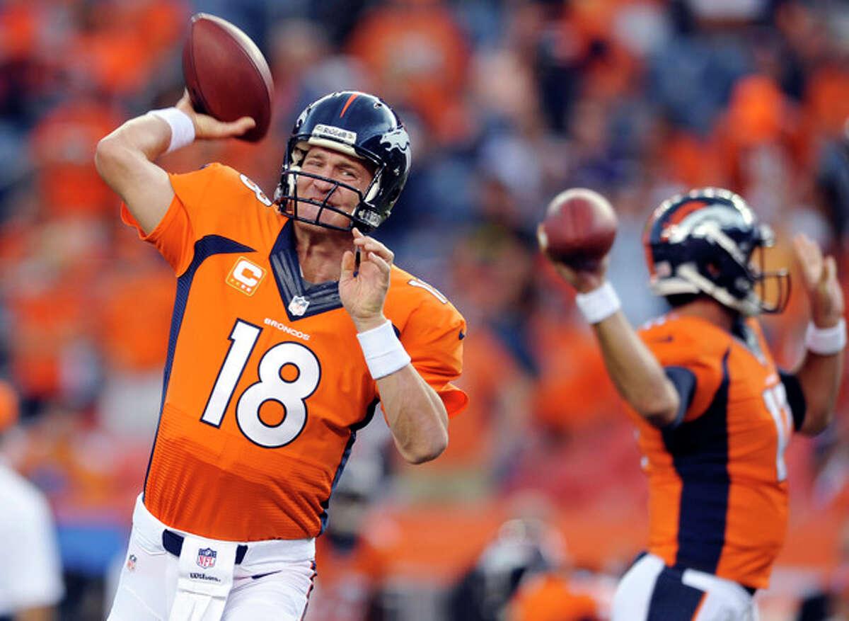 Denver Broncos quarterback Peyton Manning (18) warms up prior to the Broncos' NFL football game against the Baltimore Ravens, Thursday, Sept. 5, 2013, in Denver. (AP Photo/Jack Dempsey)
