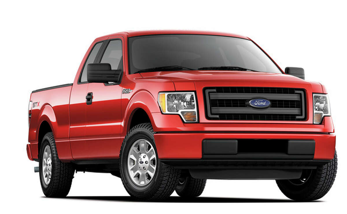 This undated photo provided by Ford shows the 2014 Ford F-150 STX SuperCrew truck. Americans are paying record prices for new cars and trucks, and they have only themselves to blame. The average sale price of a vehicle in the U.S. hit $31,252 last month, up almost $1,000 over the same time last year, a sharp increase driven by consumers loading cars up with high-end stereos, navigation systems, leather seats and safety gadgets. Many in the business think prices will moderate some because people who kept their cars through the recession and haven?'t replaced them yet won?'t load up on options. Ford will try to please them this fall by adding a four-door cab to its F-150 STX line. Previously, the STX only came with a two-door cab. (AP Photo/Ford)