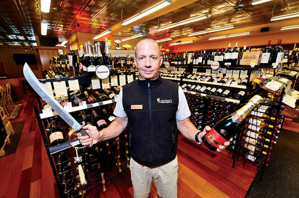 Ancona's Wines & Liquors owner Mitch Ancona will attempt on Sunday to open more than 32 champagne bottles in under one minute by cutting their tops off with a saber to be in the Guinness Book of World Records. The event will donate proceeds to the Ridgefield Library.