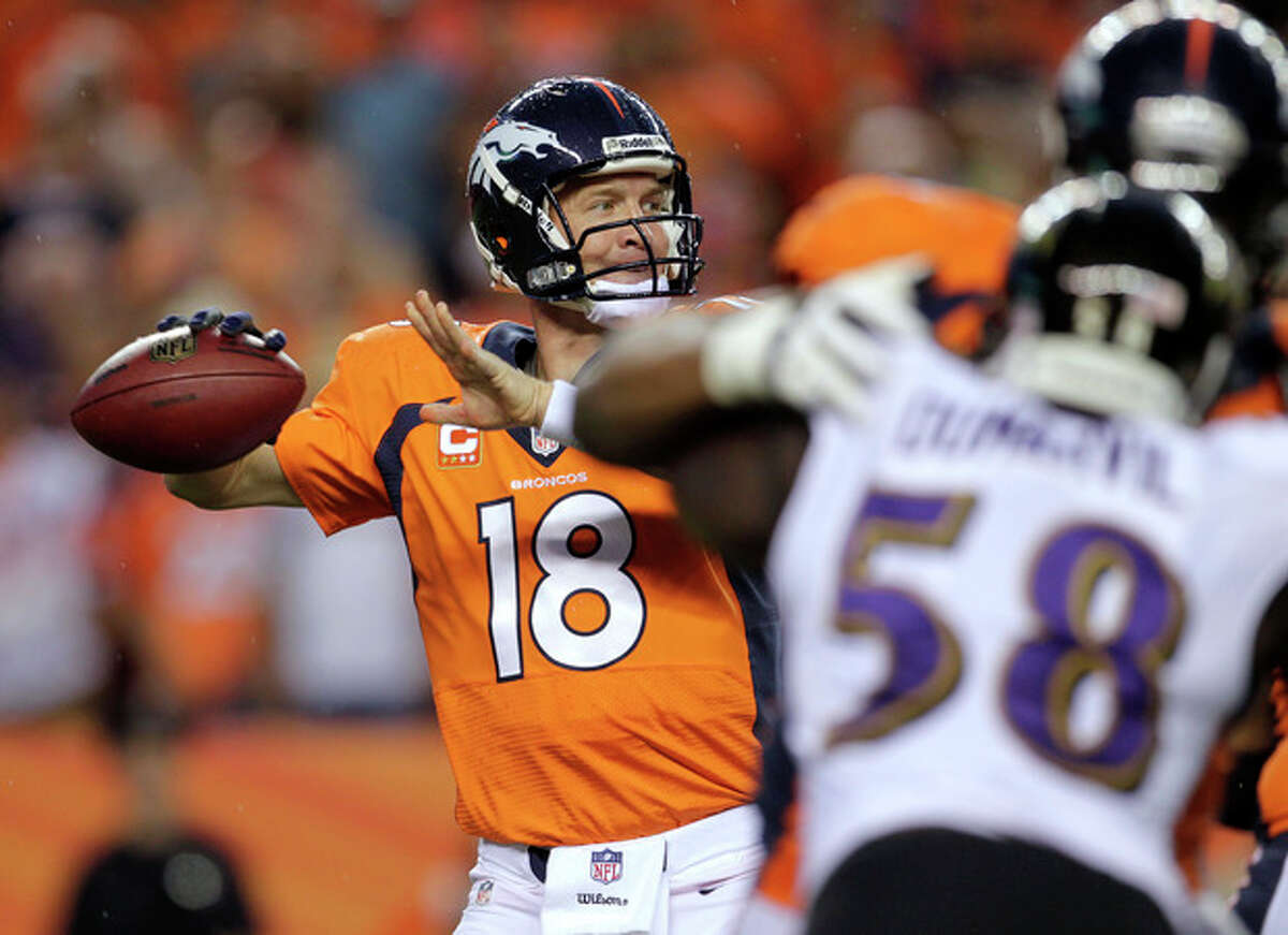 Denver Broncos quarterback Peyton Manning (18) looks to throw against the Baltimore Ravens during the first half of an NFL football game, Thursday, Sept. 5, 2013, in Denver. (AP Photo/Joe Mahoney)