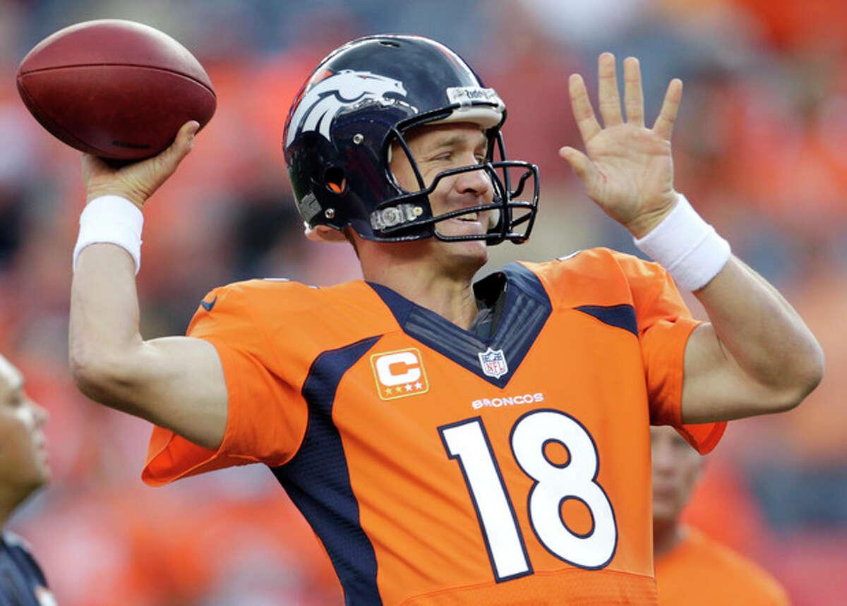 Denver Broncos quarterback Peyton Manning warms up prior to the Broncos' NFL football game against the Baltimore Ravens, Thursday, Sept. 5, 2013, in Denver. (AP Photo/Joe Mahoney)