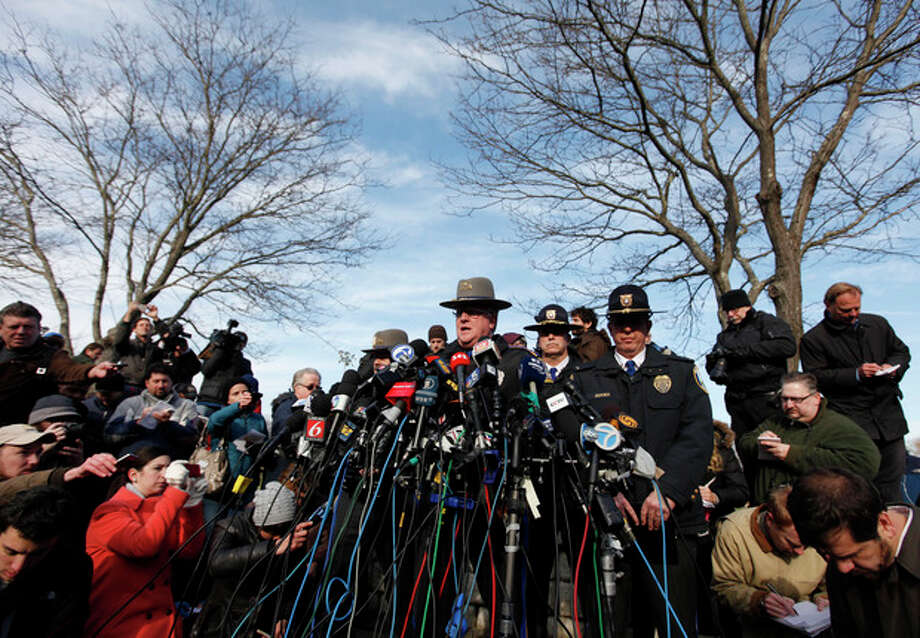 Lt. J. Paul Vance of the Connecticut State Police conducts a news briefing, Saturday, Dec. 15, 2012 in Newtown, Conn. The massacre of 26 children and adults at Sandy Hook Elementary school elicited horror and soul-searching around the world even as it raised more basic questions about why the gunman, 20-year-old Adam Lanza, would have been driven to such a crime and how he chose his victims. (AP Photo/Jason DeCrow) / FR103966 AP