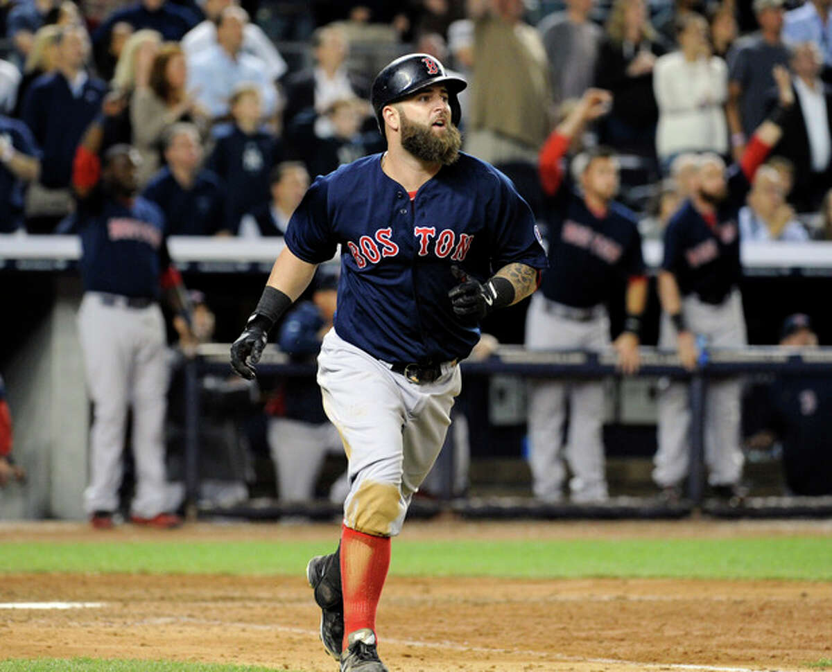 Boston Red Sox batter Mike Napoli watches his grand slam home run during the seventh inning of a baseball game against the New York Yankees, Friday, Sept. 6, 2013, at Yankee Stadium in New York. (AP Photo/Bill Kostroun)