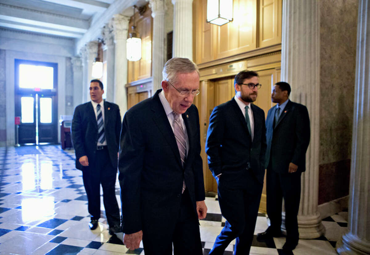 Senate Majority Leader Harry Reid of Nev. makes his way to the Senate floor on Capitol Hill in Washington, Friday, Sept. 6, 2013, to introduce a resolution to authorize military action to support President Barack Obama's request for a strike against Syria. (AP Photo/J. Scott Applewhite)