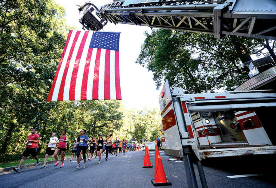 The start of the 9/11 Heroes Run 5K & 1Mile Fun Run/Walk Saturday at Cranbury Park in Norwalk. Large portions of the proceeds raised stay in the host race communities to fund your local first responder, military, and veteran nonprofits who partner with the Travis Manion Foundation. Remaining proceeds support Travis Manion Foundation Challenge Grants, which provide veterans and families of fallen service members by providing camaraderie, transition assistance, grief support, and education through service-based initiatives. Hour photo / Erik Trautmann