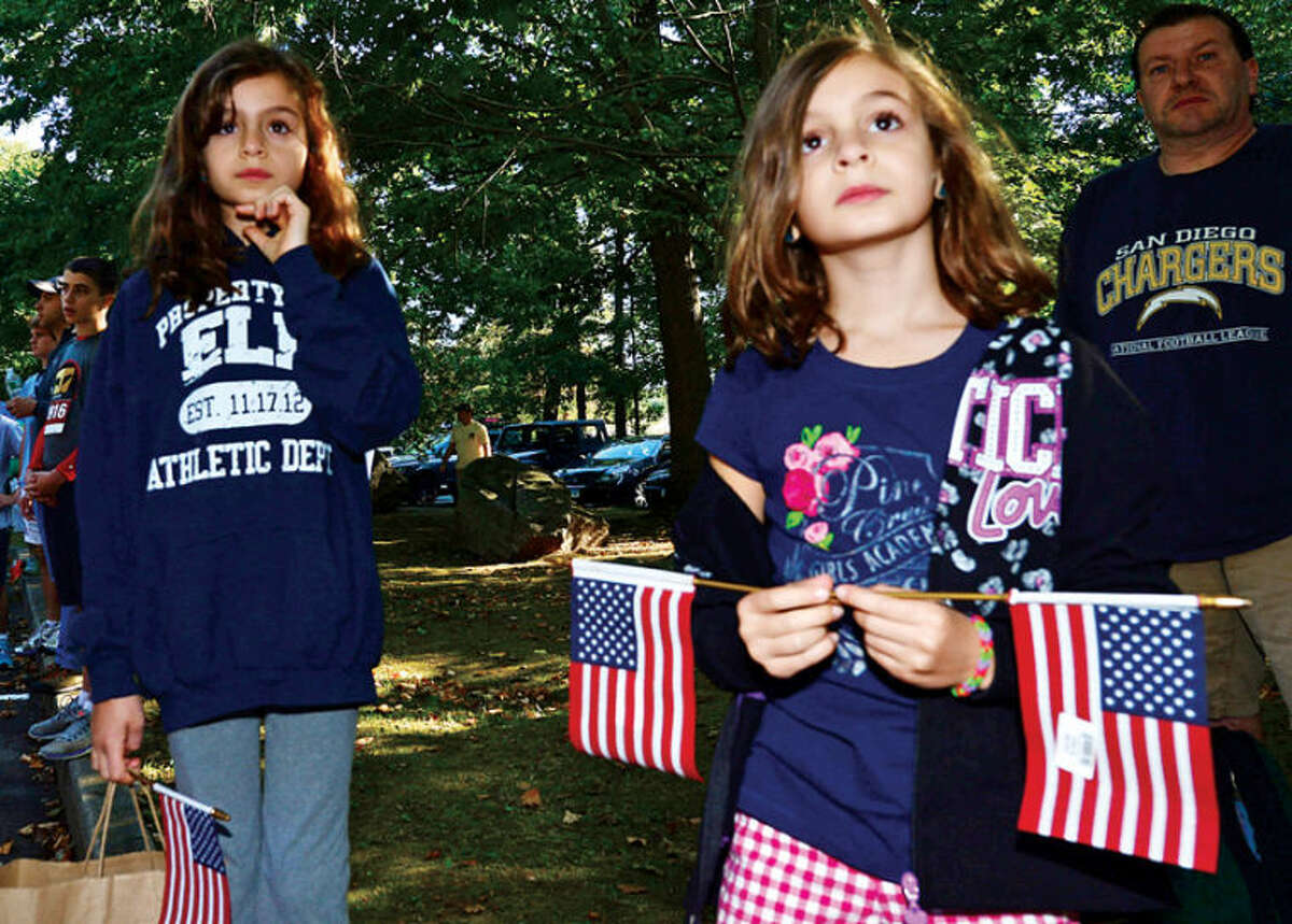 Sydney and Ella Hoffman attend the 9/11 Heroes Run 5K & 1Mile Fun Run/Walk Saturday at Cranbury park in Norwalk. Large portions of the proceeds raised stay in the host race communities to fund your local first responder, military, and veteran nonprofits who partner with the Travis Manion Foundation. Remaining proceeds support Travis Manion Foundation Challenge Grants, which provide veterans and families of fallen service members by providing camaraderie, transition assistance, grief support, and education through service-based initiatives. Hour photo / Erik Trautmann