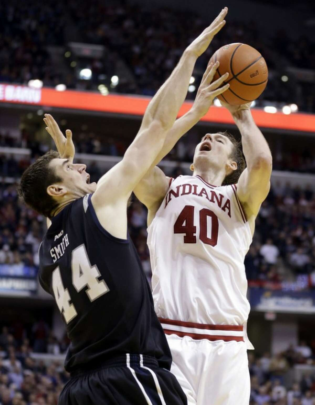 Indiana forward Cody Zeller, right, shoots over Butler center Andrew Smith in the second half of an NCAA college basketball game in Indianapolis, Saturday, Dec. 15, 2012. Butler defeated Indiana 88-86 in overtime. (AP Photo/Michael Conroy)