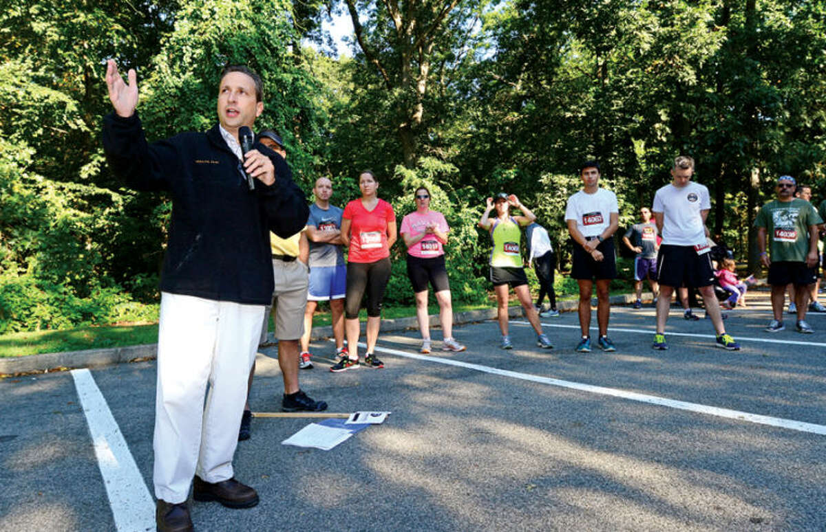 State senator Bob Duff (D-25) address attendees at The 9/11 Heroes Run 5K & 1Mile fun run/walk saturday at Cranbury park in Norwalk. Large portions of the proceeds raised stay in the host race communities to fund your local first responder, military, and veteran nonprofits who partner with the Travis Manion Foundation. Remaining proceeds support Travis Manion Foundation Challenge Grants, which provide veterans and families of fallen service members by providing camaraderie, transition assistance, grief support, and education through service-based initiatives. Hour photo / Erik Trautmann