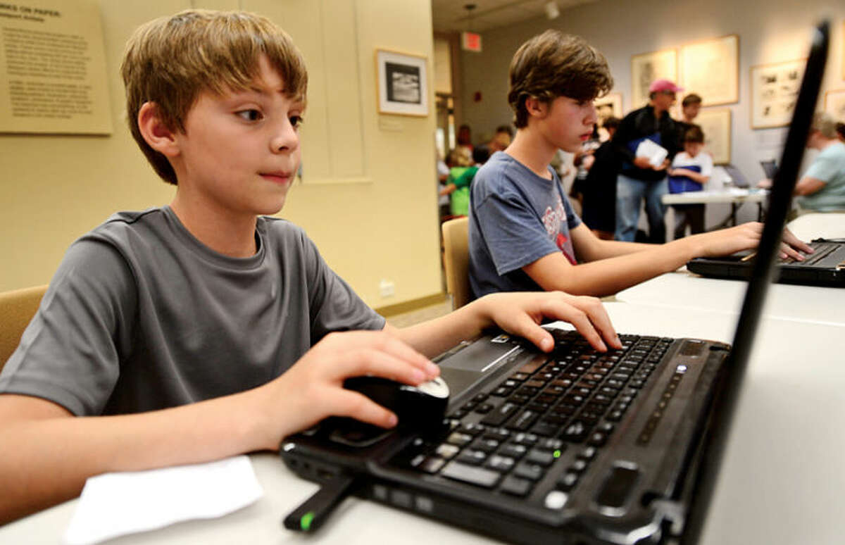 Shane Selinger plays Minecraft at the Westport Public Library's Minecraft Day, where teens connect to county wide server to play the popular game Saturday. Hour photo / Erik Trautmann